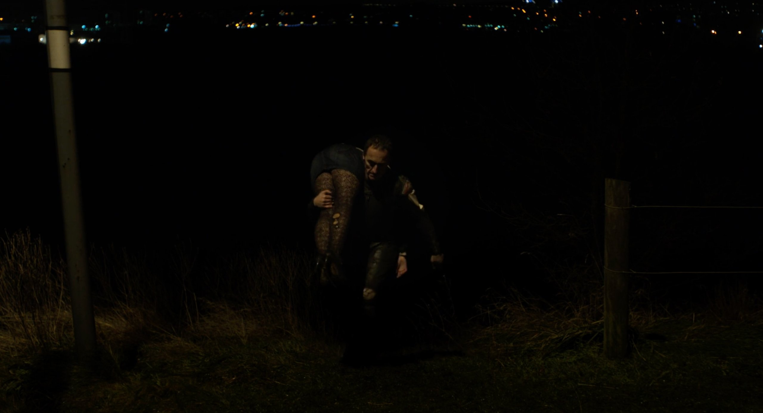 The Motorcycle Man carries a dead woman in Under the Skin