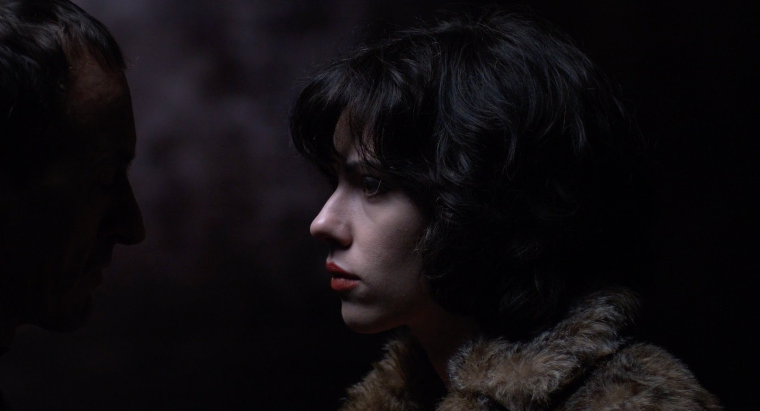 The Motorcycle Man inspects Scarlett Johansson in Under the Skin