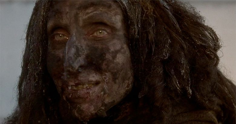 The ugly homeless woman smiles in Mulholland Drive