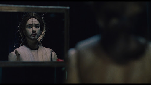 A puppet of Craig stares into the mirror in Being John Malkovich