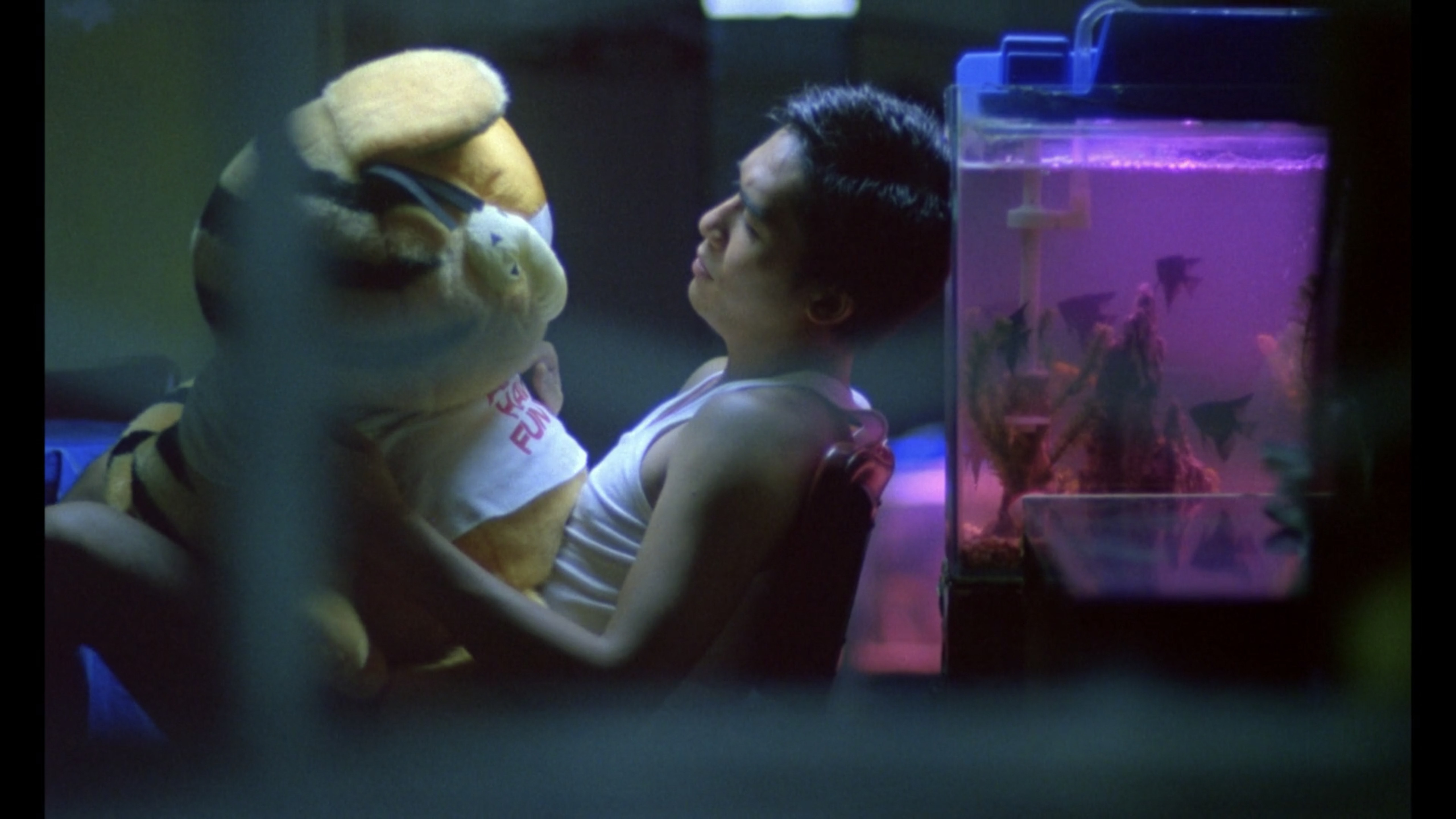 Cop 663 sits with his Garfield stuffed animal in Chungking Express