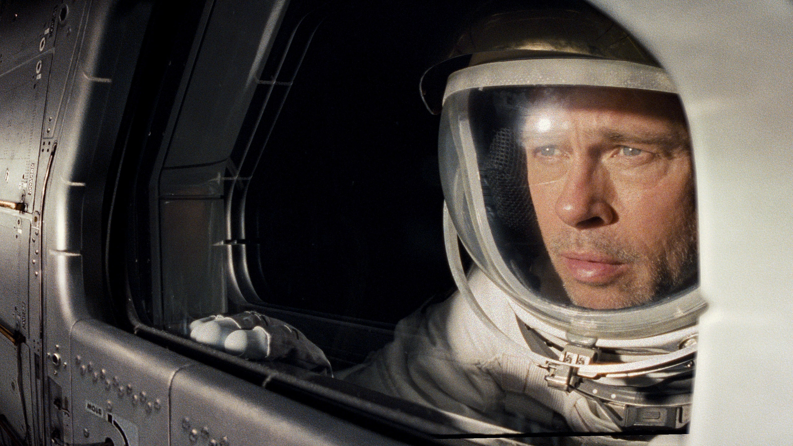 Roy McBride (Brad Pitt) peers out the window of a spaceship in Ad Astra