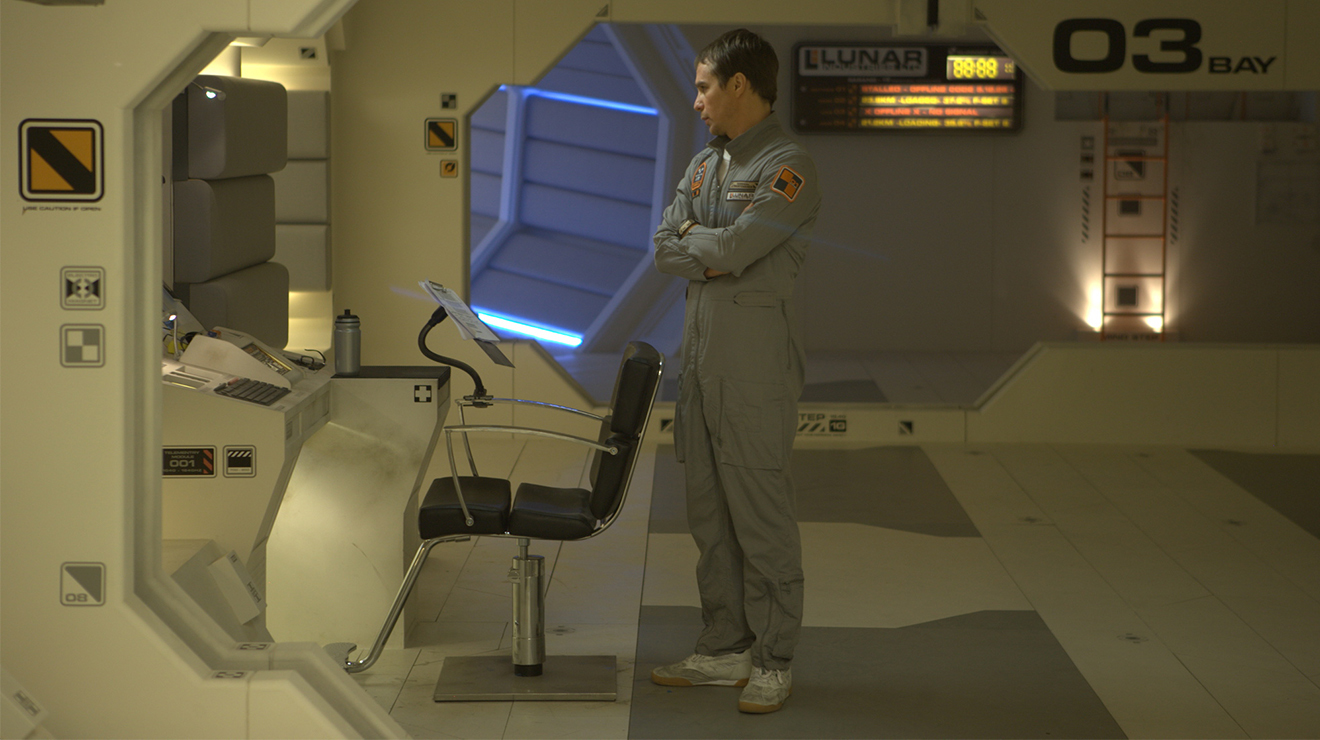 Sam Bell (Sam Rockwell) stands in a station at a lunar mine in Moon