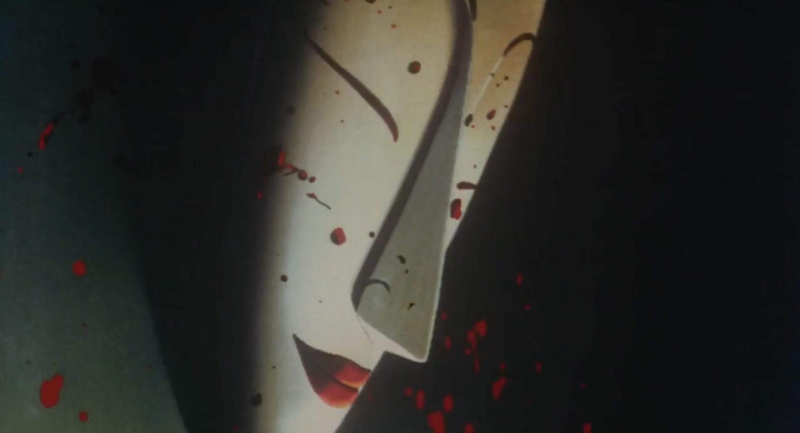 A Japanese Noh mask is splattered with blood in Perfect Blue