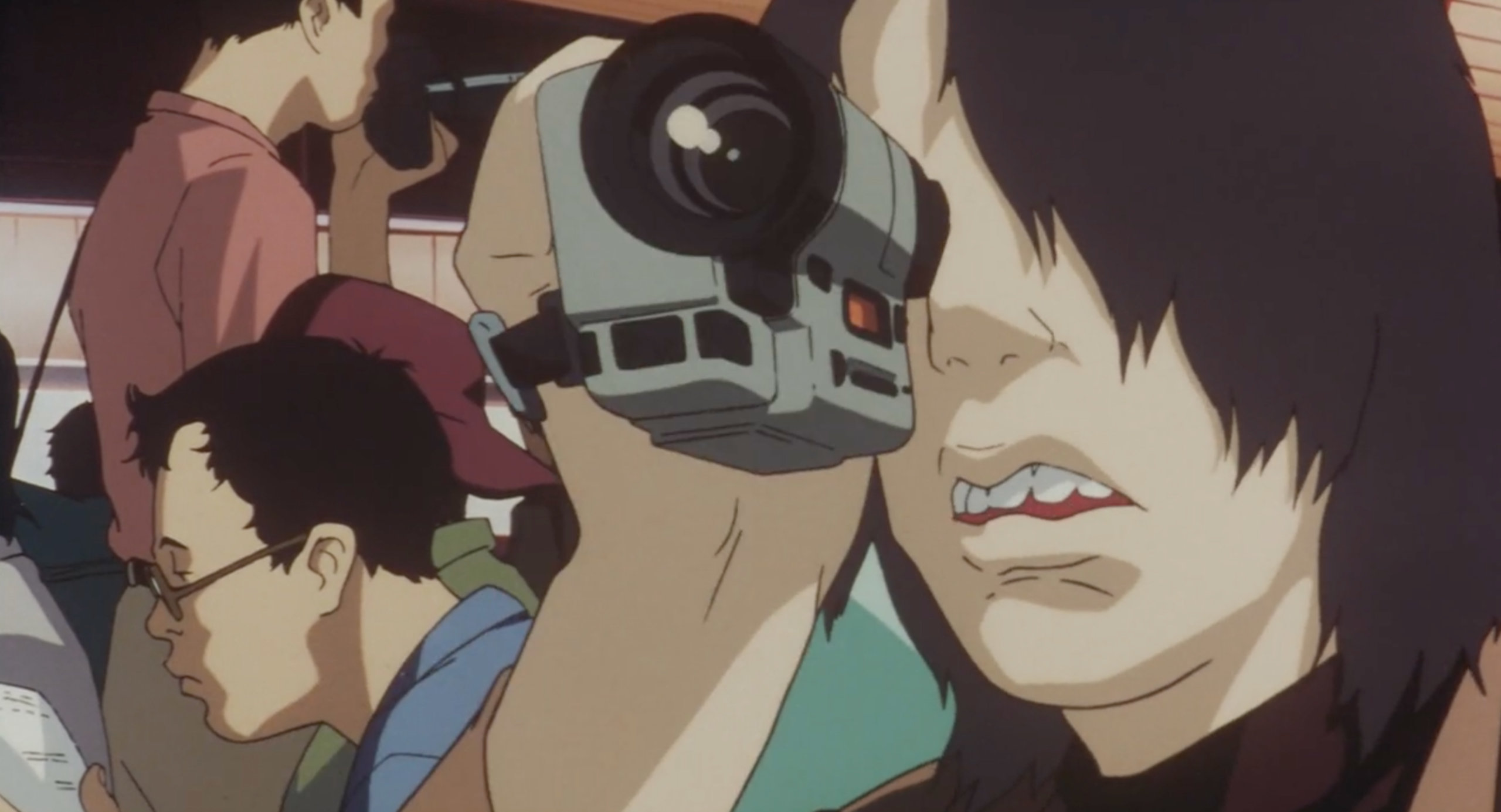 Me-Mania videotapes a poster of CHAM! in Perfect Blue