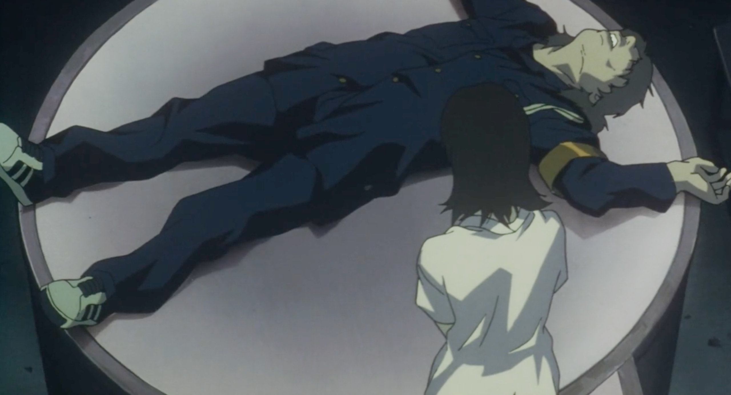 Mima stands over the body of Me-Mania after murdering him in in Perfect Blue