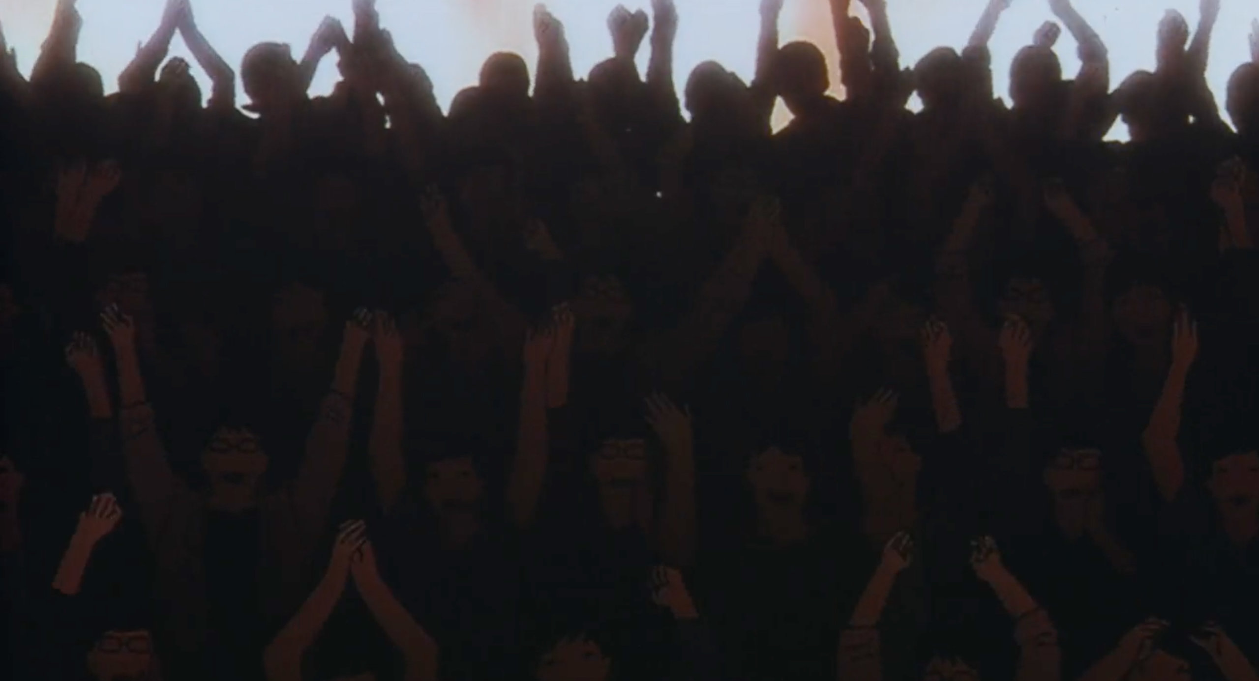 A crowd cheers for Mima after a rape scene for Double Bind in Perfect Blue