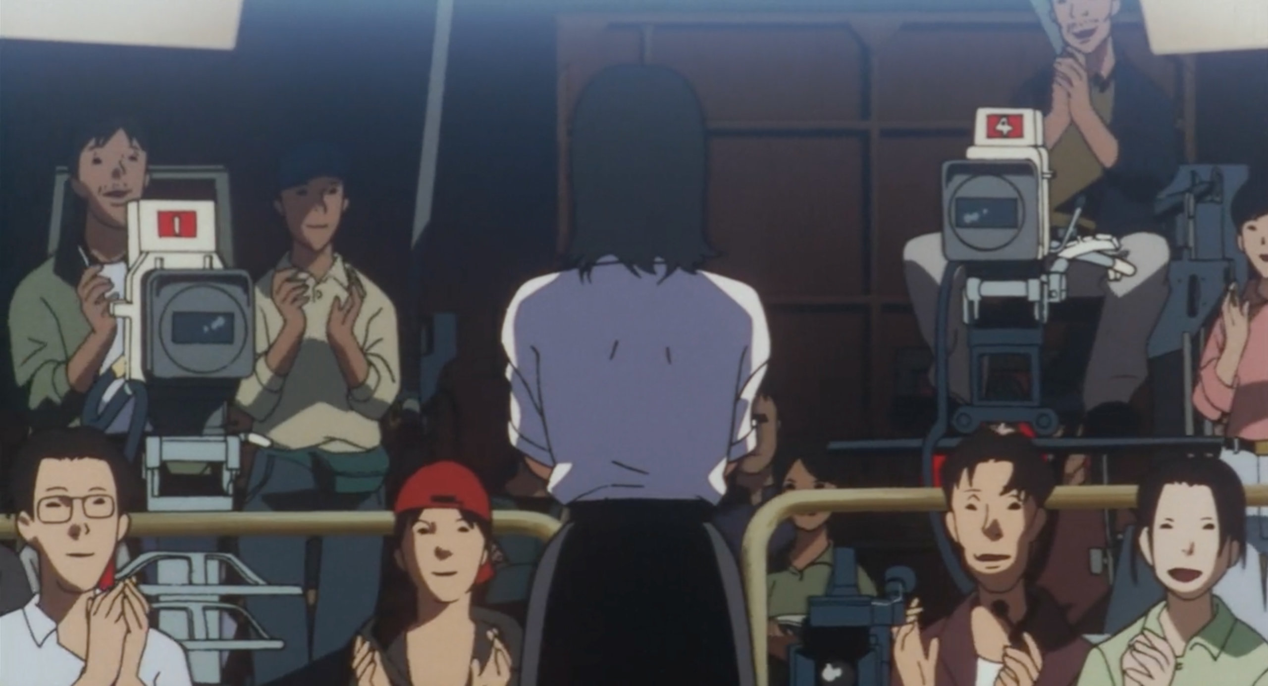 The Double Bind crew applauds Mima after a shoot in Perfect Blue
