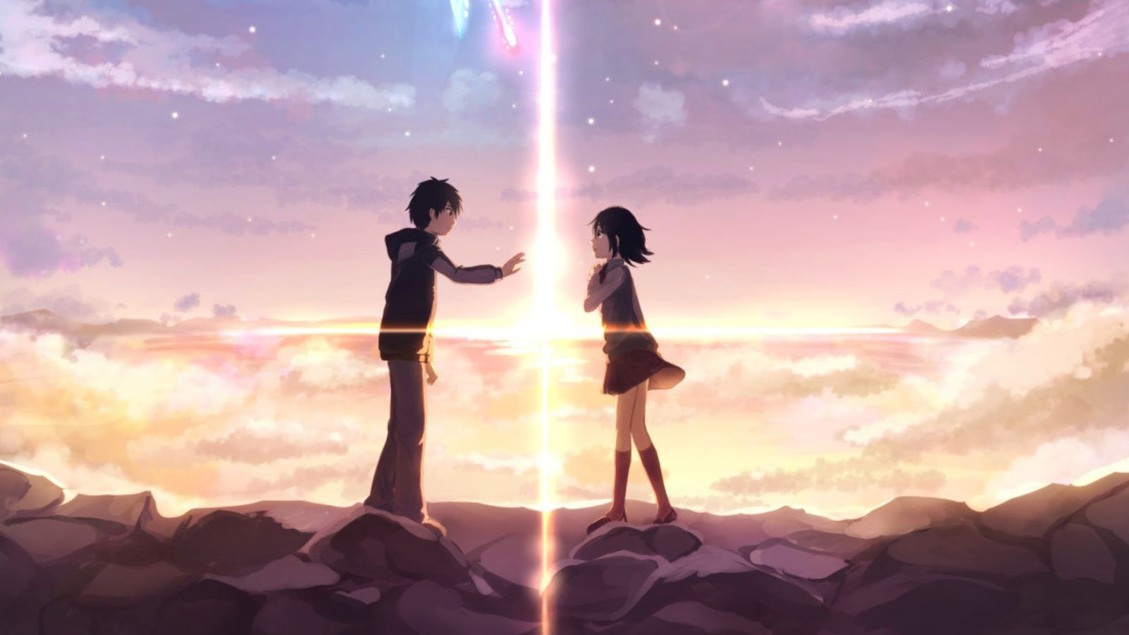 Mitsuha and Taki finally meet and touch hands at the twilight hour in Your Name