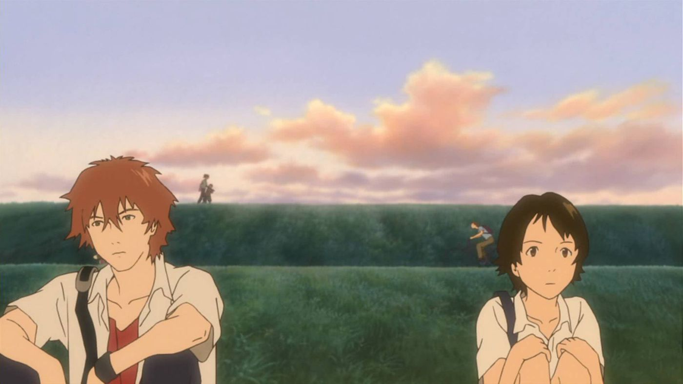 Chiaki and Makoto sit together outside a field in The Girl Who Leapt Through Time